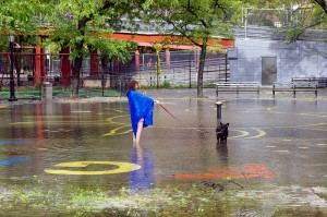 photo of woman and dog in flood