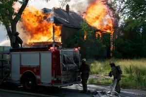 firemen fight a house fire
