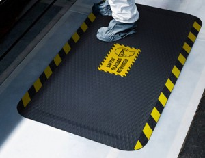 worker on safety message mat