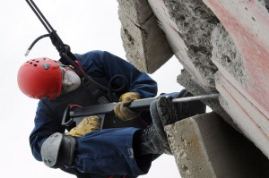 photo of worker jackhammering concrete