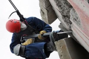 photo of worker jackhammering concrete