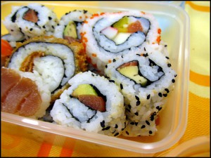 photo of sushi in plastic container