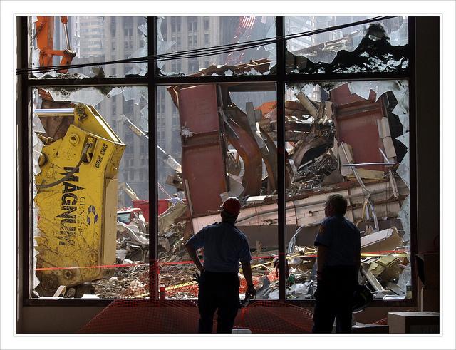Workers Watching Broken Glass Window
