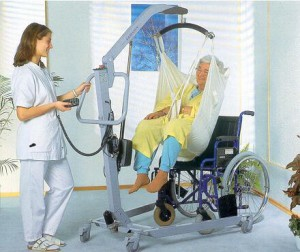 photo of elderly patient and mechanical lift device