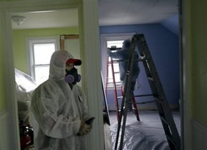 Contractors and remodelers who may be exposed to lead paint wear respirators to mitigate their exposure. (Photo via pennlive.com)