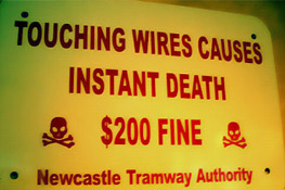 touching wires causes instant death funny safety sign