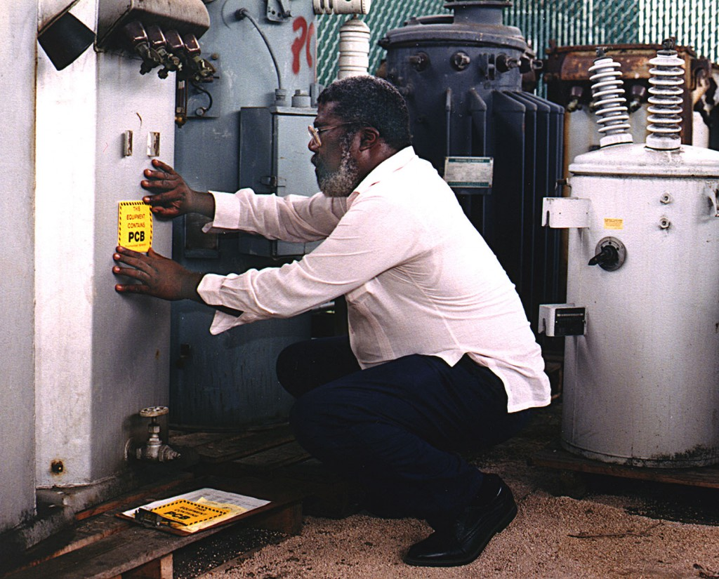 photo worker applying pcb label