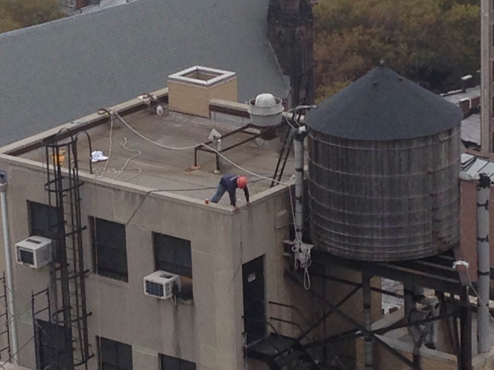 worker on roof without fall protection