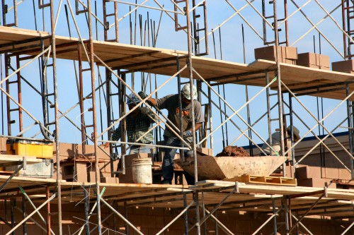 workers on construction scaffolding