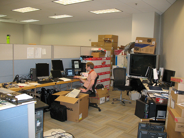 A cluttered cubicle in the office. Image by: James Emery