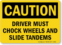 Driver Must Chock Wheels And Slide Tandems Sign