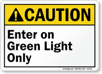 Enter On Green Light Only Caution Sign