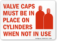 Valve Caps Must Be In Place Sign
