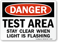 Stay Clear When Light Is Flashing Sign