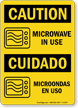 Bilingual OSHA Caution/Cuidado Sign