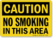 Caution: No Smoking In This Area Sign