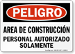Spanish OSHA Danger Construction Area Authorized Personnel Only Sign