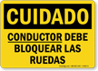 Spanish OSHA Caution Driver Must Chock Wheels Sign