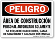 Spanish OSHA Danger Construction Area PPE Required Sign